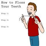 Man Using Dental Floss Stock Photo