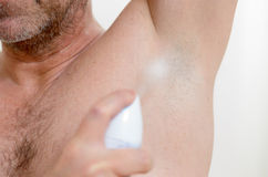 Man using a deodorant Stock Photos