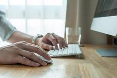 Man using desktop pc computer, mobile office concept Stock Photo
