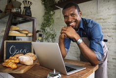 Man using devices for online business order at bakehouse stock images