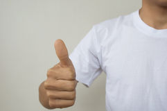 A man using digital interface with his thumb on air Stock Photography