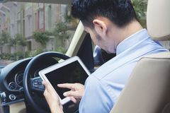 Man using digital table with copy space while driving.  Stock Photography
