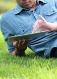 Man Using digital tablet Stock Photos