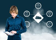 Man using digital tablet against cloud computing concept in background Stock Images