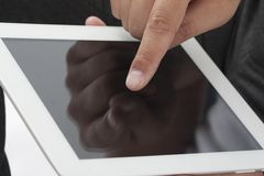 Man using a Digital Tablet Royalty Free Stock Photography