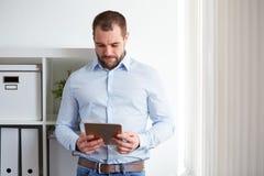 Man using digital tablet Stock Photo