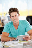 Man Using Digital Tablet In Busy Creative Office Stock Photos