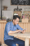 Man using digital tablet in cafe Stock Photos