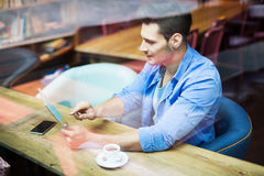 Man using digital tablet at cafe Royalty Free Stock Photos