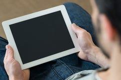Man using digital tablet Royalty Free Stock Photos