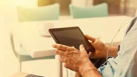 Man using digital tablet in free time Stock Photos