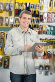 Man Using Digital Tablet In Hardware Store Royalty Free Stock Photo