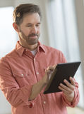 Man Using Digital Tablet At Home Stock Photos