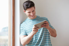 Man Using Digital Tablet At Home Royalty Free Stock Photo