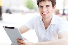 Man using digital tablet outdoors Stock Photo