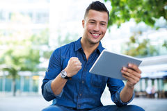 Man using digital tablet outdoors Royalty Free Stock Photo