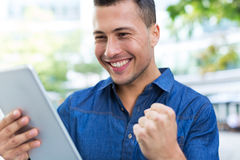 Man using digital tablet outdoors Stock Images