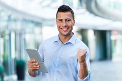 Man using digital tablet outdoors Royalty Free Stock Photography