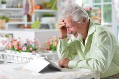 Man  using digital tablet. Portrait of a happy senior man using digital tablet Royalty Free Stock Photography