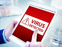 Man Using a Digital Tablet with Virus Stock Images