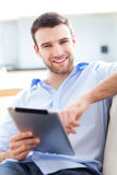 Man using digital tablet Royalty Free Stock Image