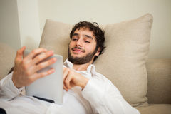 Man using a digital tablet Stock Photography