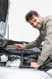 Man using dipstick to check oil Stock Image