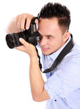 Man using dslr camera. Portrait of man using camera ready to take photo Royalty Free Stock Image