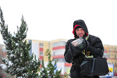 Man using dslr raincoat in winter Royalty Free Stock Images