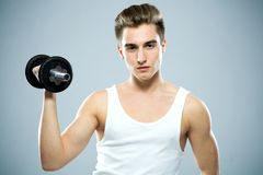 Man using a dumbbell Stock Photography