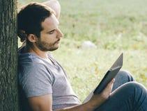 Man using e-book reader Stock Image