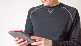 Man Using an E-Reader Device Stock Photo