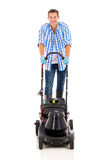 Man using electric mower Royalty Free Stock Photo