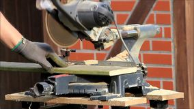 Man using electric saw to cutting wood. Man using electric saw, cutting wood stock footage