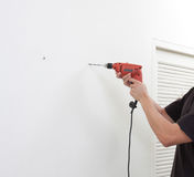 a man using an electric screwdriver Royalty Free Stock Photography