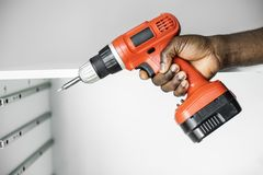 Man Using Electronic Drill Install Cabinet Royalty Free Stock Photo