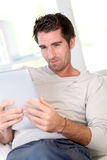 Man using electronic tablet Stock Images
