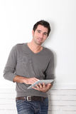 Man using electronic tablet Royalty Free Stock Image