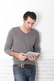 Man using electronic tablet Stock Photo