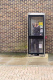 Man using and English Phone Box Royalty Free Stock Image
