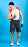 Man using exercise tubing to strengthen upper arm. Stock Image