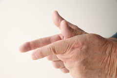 Man using finger shooting gesture Royalty Free Stock Photography