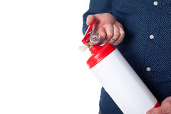 Man using fire extinguisher Stock Photography