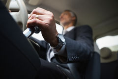 Man using a gear stick Royalty Free Stock Image