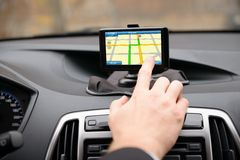 Man using gps navigation while driving Stock Images