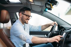 Man Using Gps Navigation System In Car to travel Royalty Free Stock Photography