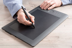 Man using graphical tablet Royalty Free Stock Images