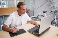Man using graphics tablet to do work Stock Photography