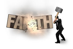 Man using hammer cracking FAITH word wooden board. Stock Images
