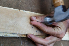 Man using a hammer on wood Royalty Free Stock Photography